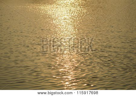 water surface with ripples and reflection of landscape