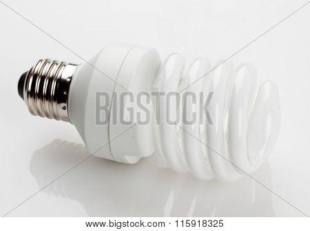 Fluorescent white light bulb isolated on white background.
