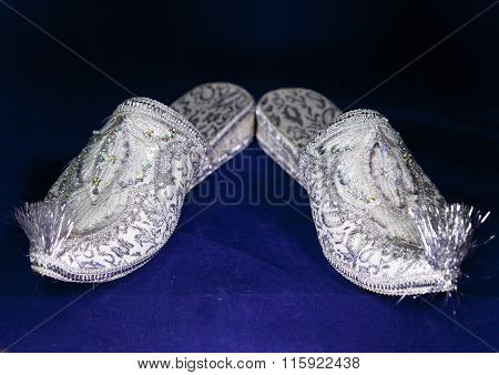 east style bride wedding shoes on a blue velvet
