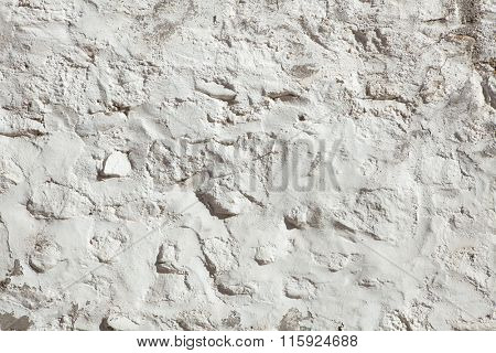 Whitewashed stone and clay wall. Background texture.