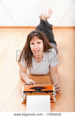 Women Typing Typewriter