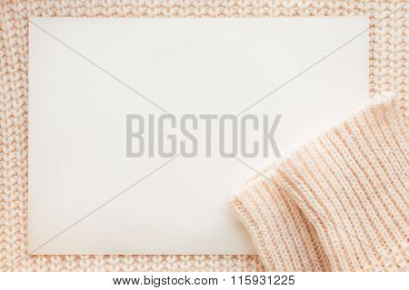 Abstract Knitted Background With Clear Paper. Wool Sweater With Sleeves.
