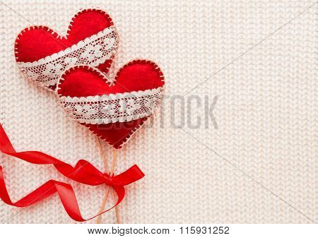 White Woven Background With Two Felt Hearts With Laces, Symbol Of Love. Good For Valentine's Day