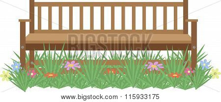 Wooden Bench On The Lawn With Flowers