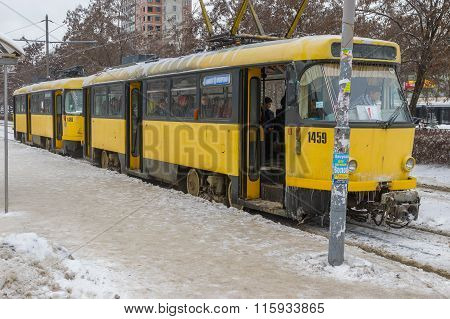 Ice-covered tram is waiting new passengers to come