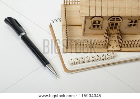 Concept of housing purchase and insurance. Office desk table with supplies top view. Pen, notepad, m