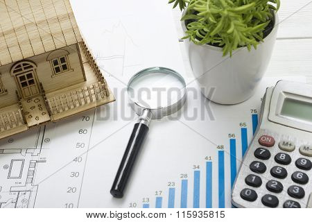 Model house, construction plan for house building, magnifying glass compass. calculator. Real Estate