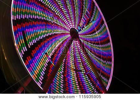 Horizontal, moving ferris wheel ride