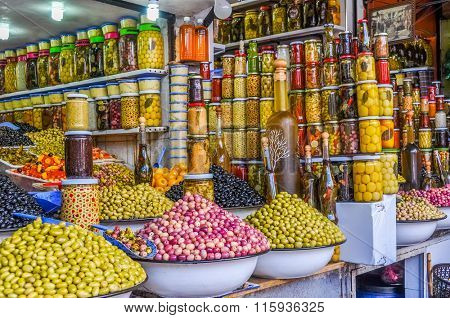 MARRAKESH, MOROCCO, APRIL 3, 2015: Jemaa el-Fnaa square -  -  different types of olives displayed on street stand