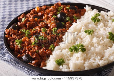 Cuban Food: Picadillo With A Side Dish Of Rice Close-up. Horizontal
