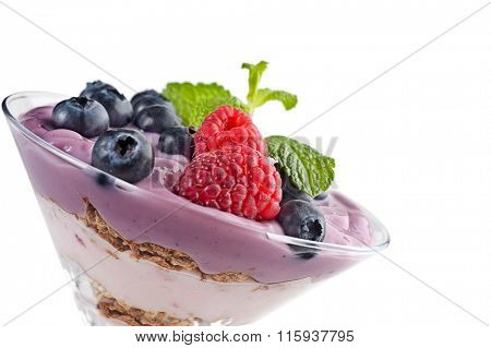 Extreme close-up image of fruit yogurt and cereal on white background