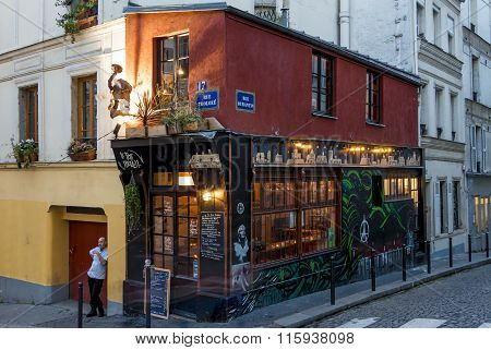 The Mini-bistrot Du Petit Moulin In Evening, Paris, France.