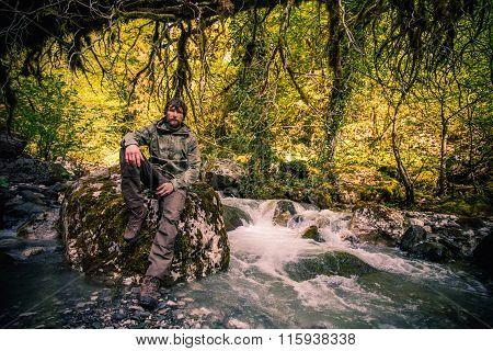 Young Man bearded relaxing hiking outdoor