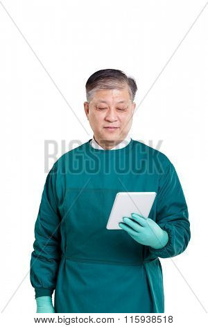 old asian man surgery doctor in gown using digital tablet