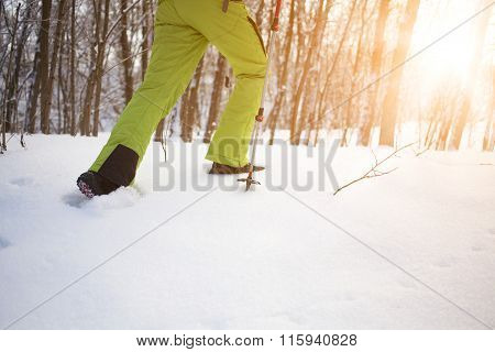 The Athlete Walks In The Snow.
