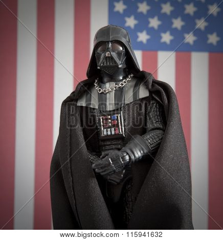 BLOOMFIELD NJ - JAN 24 2016: Darth Vader action figure standing in front of an American Flag. Vote for Vader concept