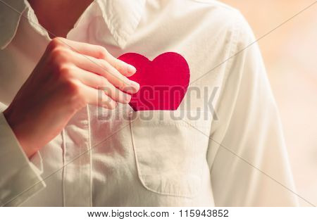 Heart shape love symbol in woman hands