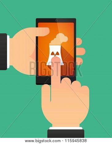 Hands Using A Phone Showing A Nuclear Power Station