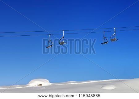 Chair-lift And Blue Clear Sky At Sunny Day