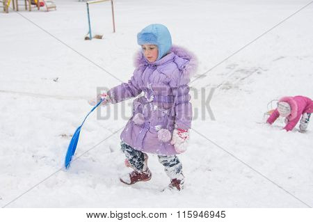Girl Wearily Climbs Icy Hill