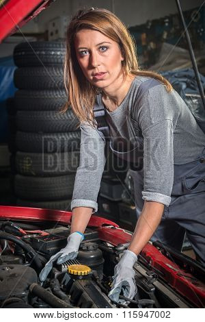 Female car mechanic in auto repair service