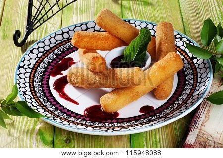 cheese sticks with breaded mint cranberry sauce still life beautiful wooden table Provence the menu close-up food