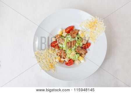 Caesar salad grilled chicken and parmesan crisps plate top white background isolated
