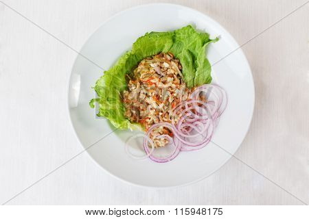 chicken salad, pickled cucumber and carrot on lettuce red onion round saucer top menu Series