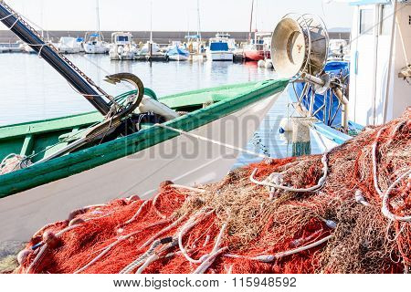 Fishing Net And Boats Waiting For The Small Marina.