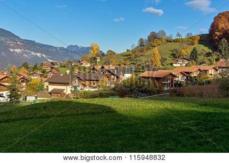 Green meadows and typical Switzerland village near town of interlaken, canton of Bern, Switzerland