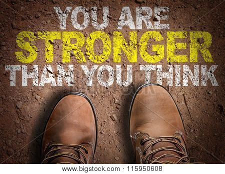 Top View of Boot on the trail with the text: You Are Stronger Than You Think