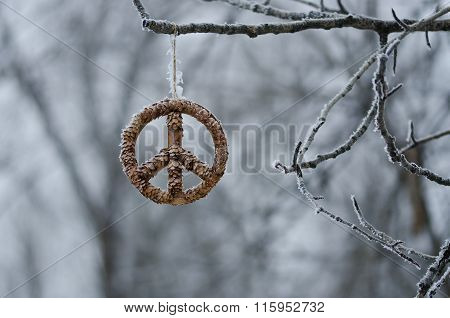 Frozen Peace Sign Hanging Alone In The Winter Forest