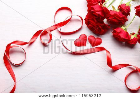 Two Hearts, Red Ribbon And Beautiful Roses