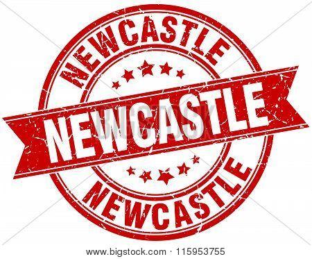Newcastle red round grunge vintage ribbon stamp