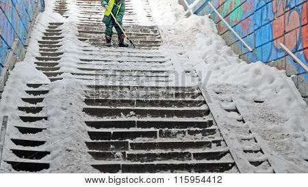 Cleaning  Ladder Of Snow And Ice.