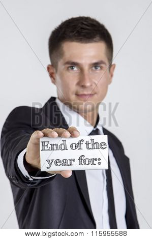 End Of The Year For: - Young Businessman Holding A White Card With Text