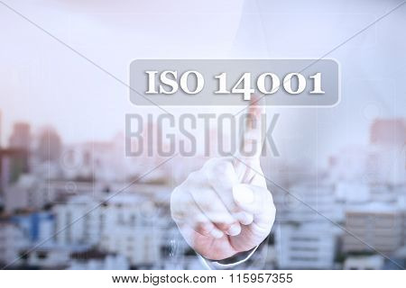 Businessman hand touch screen graph on ISO 14001.