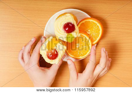 Hands Take Gourmet Cream Cake Cookie And Orange