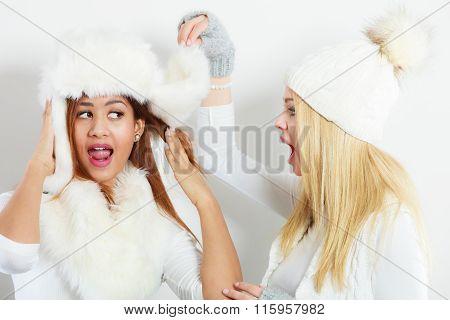 Two Girls In Winter Clothing Whispering Secret