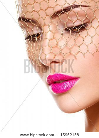 Fashion portrait of a beautiful  girl wears veil on eyes. bright make-up. Isolated on white background