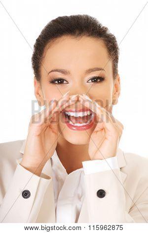 Businesswoman whispering gossip.