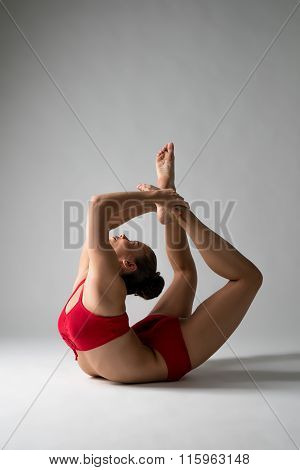 Cute girl performs difficult gymnastic element