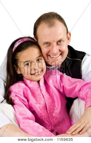 A Father And His Daughter In Traditional Indian Clothing