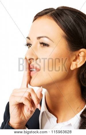 Portrait of businesswoman making silent sign