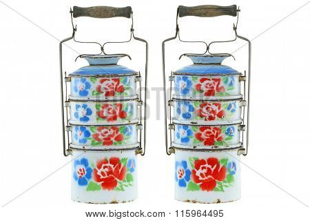 Vintage rusty metal food carrier (Tiffin carrier) in white with colorful flowers isolated on white background