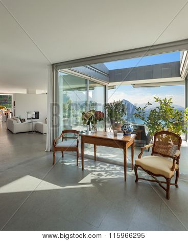 Modern house, beautiful interiors, classic decor and veranda view