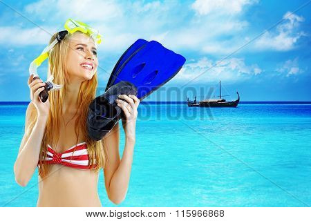 Young woman with diving mask and flippers on beautiful sea background
