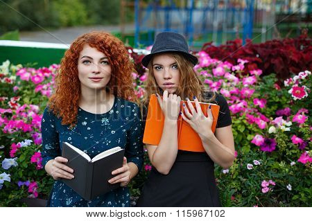 Girlfriends Read Book In The Park.