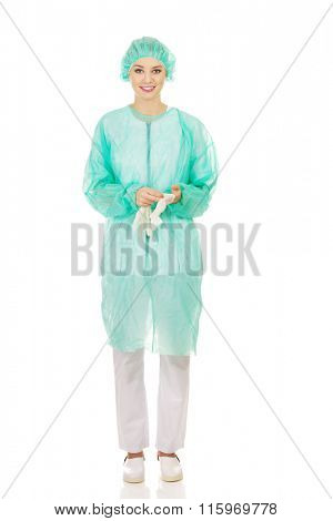 Woman doctor wearing medical gloves.