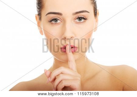 Beauty woman making hush gesture.